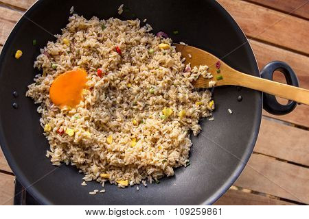 Fried Rice With Yolk In Frying Pan