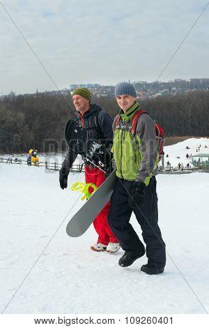 Two Cheerful Snowboarders On Ski Resort