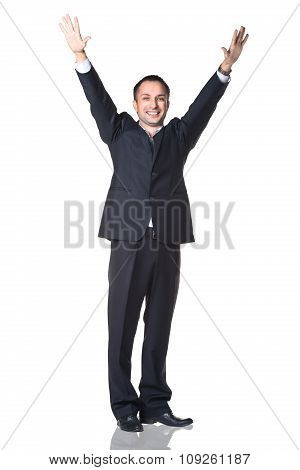 Man smiling with hands up