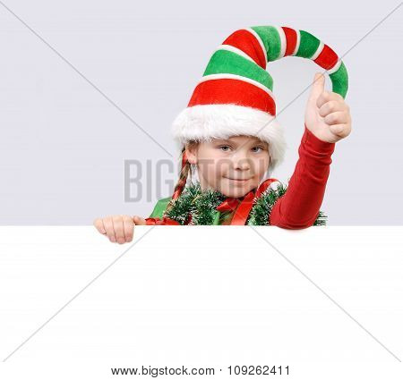 Girl - Santa's elf showing sign OK with the banner