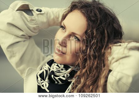 Happy beautiful fashion woman with long curly hairs outdoor