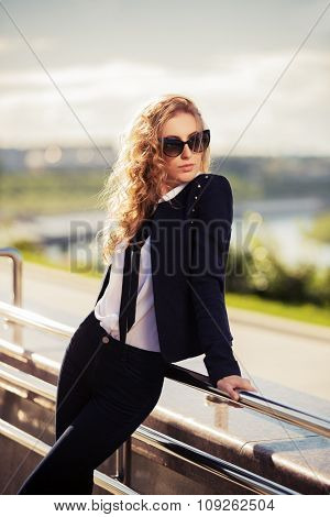 Young fashion woman in sunglasses on the city street
