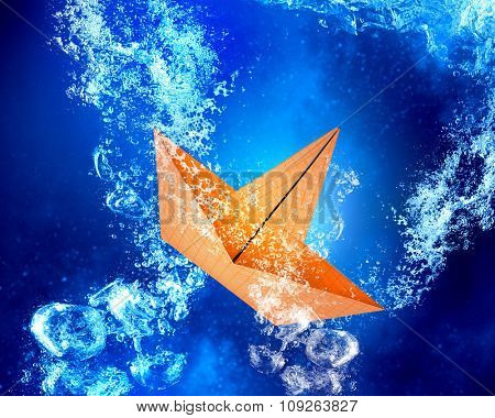 Paper ship sinking in clear blue water