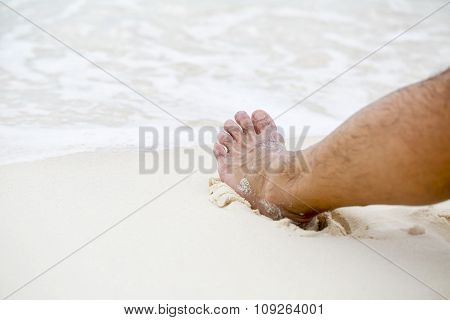 Man's Bare Foot On The Caribbean Beach.