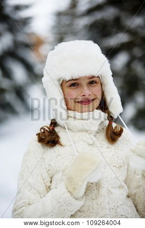 Winter vacation, snow - beautiful and young girl enjoying winter
