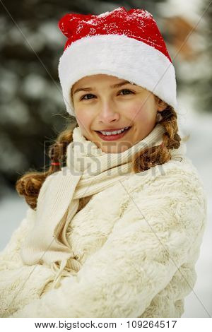 Winter vacation, winter holiday - beautiful and young girl enjoying winter