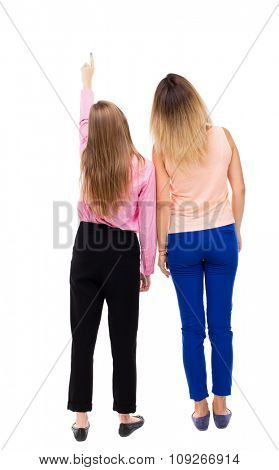 Back view of two pointing young girl. Rear view people collection.  backside view of person.Rear view. Isolated over white background. two girls looked up staring at something in the sky.