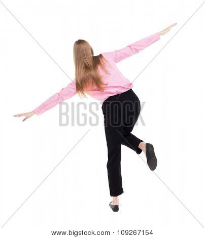 Balancing young business woman or dodge falling woman. Rear view people collection. backside view person. Isolated over white. girl office worker in black pants standing on one leg, arms to side