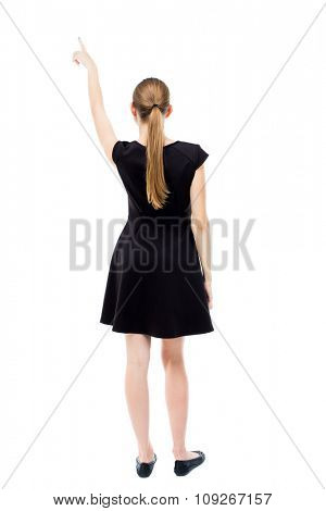 Back view of  pointing woman. beautiful girl. Rear view people collection.  backside view of person. Isolated over white background. blonde in a black dress pointing at something interesting in sky