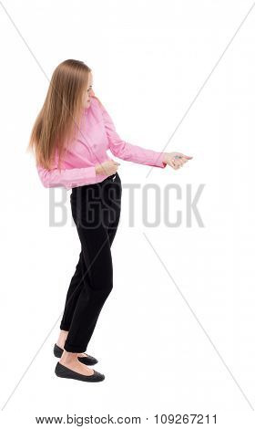 back view standing business woman pulling rope from the top or cling to something. girl  watching. Isolated over white background. girl office worker in black slacks standing sideways pulls on rope