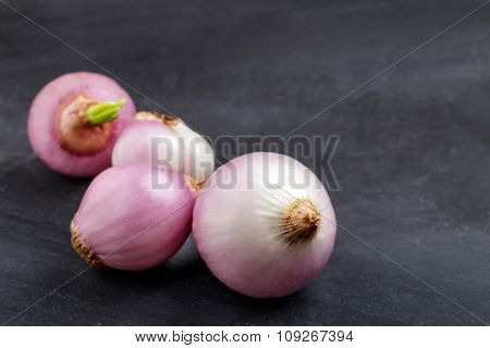 Peel Shallot On Black Board