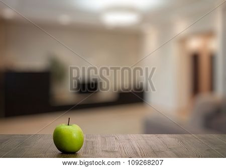 green apple on wooden table in the living room
