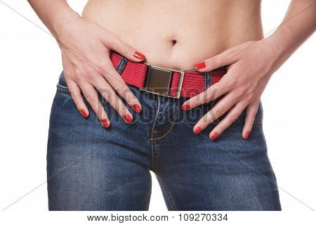woman with hands on hips wearing jeans