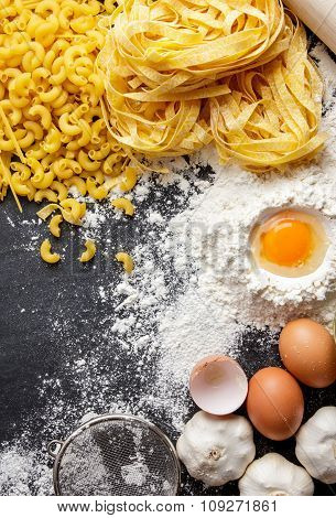 Raw Homemade Macaroni Pasta And Fettucine With Ingredients