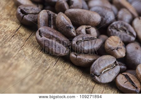 coffee grains on grunge wooden  closeup background