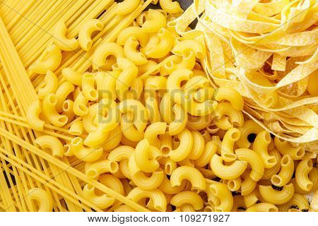 Raw Homemade Italian Pasta, Macaroni, Spaghetti, And Fettucine