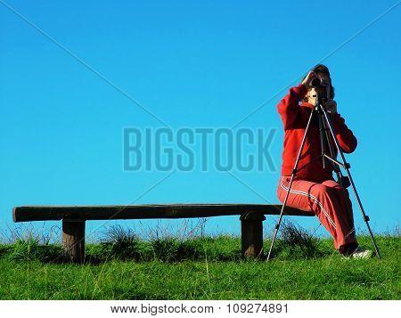 Girl exploring the mountain landskape with spyglass