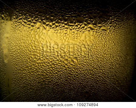 Condensed water drops on the glass with ice cold juice or beer