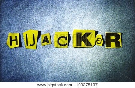Hijacker headline on blue background with yellow cutout letters