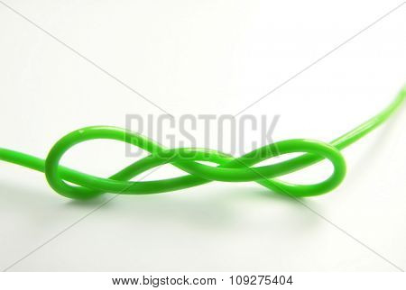 Isolated green plastic wire.Green knot