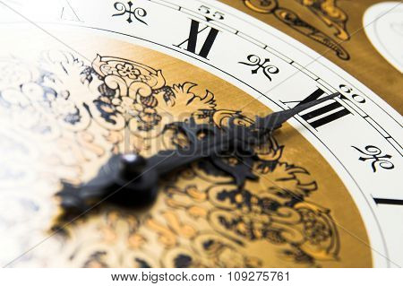 Old clock face showing the time. Midnight time on the clock