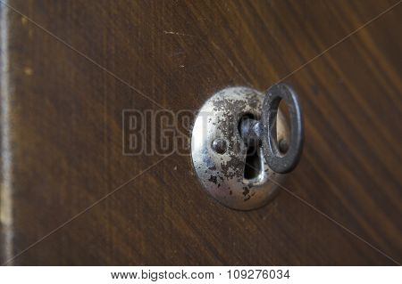 Old Key Hole. Key Hole with a key