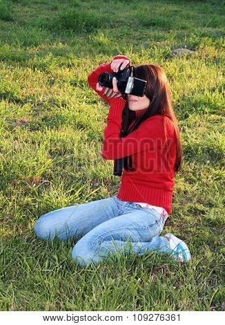 Young woman photographer and digital camera