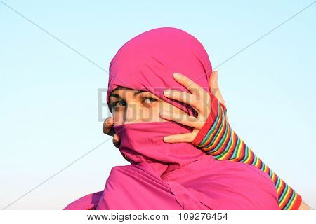 Mysterious muslim woman behind scarf and hands holding her head