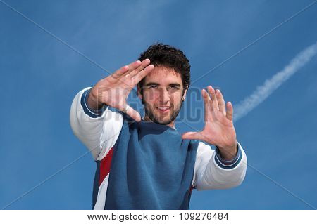 Happy young positive man. Happy student pointing hands. Strong and positive person concept