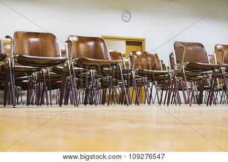 Empty classroom. Clock and open door in empty university classroom without students