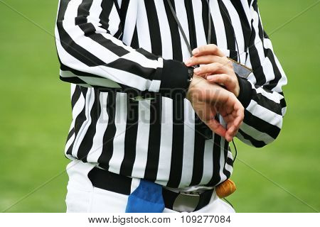 American football Referee looking on time. Sports justice concept