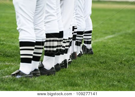 Men standing in line. League referee concept
