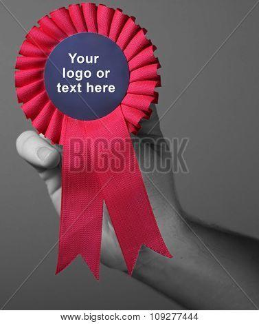 Red award ribbon badge. Success symbol and winning concept