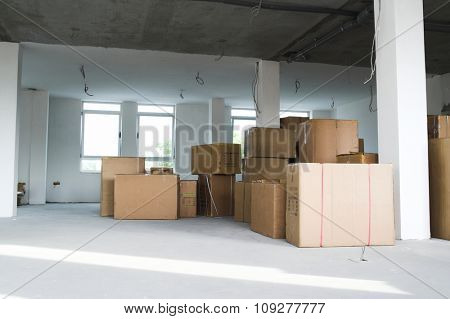 Warehouse building. Storage boxes in industrial warehouse. Logistics concept
