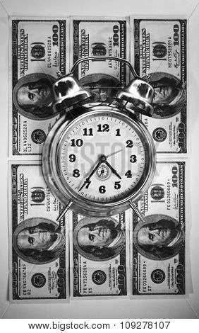 Retro clock on american dollar. Time in money  business concept