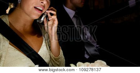 Young business woman talking and driving in car