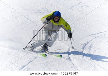 Skier on a snow slope in high speed. winter sports concept