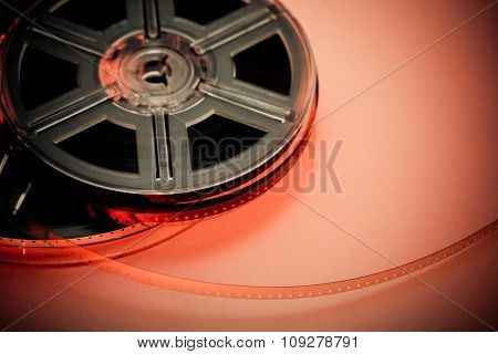 Red and black film reel concept background. Focus on film. Movie industry.