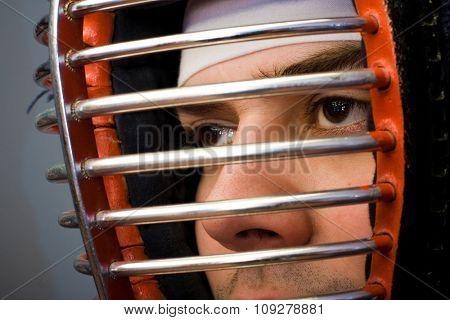 Martial arts concept portrait Man in kendo helmet closeup on eyes