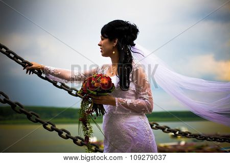 Bride portrait with bouquet of flowers. Soft dreamy look, sharp eyes and face