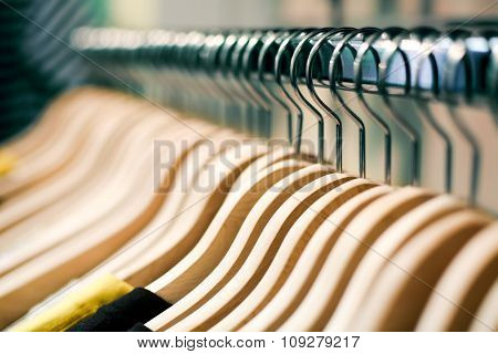 Clothes hangers with shirts in a store ready to sell. Fashion shopping store concept