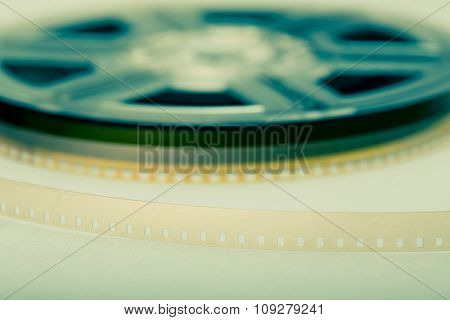 Film reel in background and focus on film. Movie industry symbol