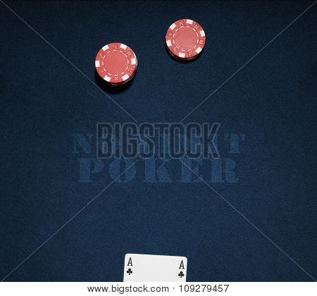 Casino chips on a blue background with no limit word. Vegas poker concept
