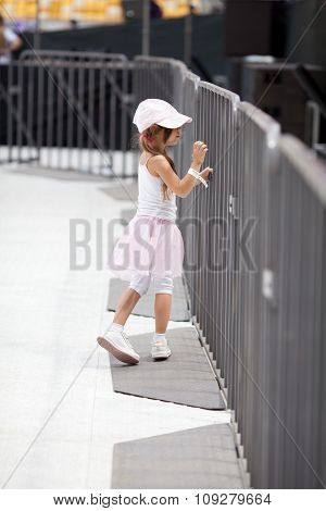 Adorable Little Girl On The Stadium