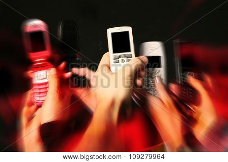 Many Cell phones and hands. Mobile communication concept