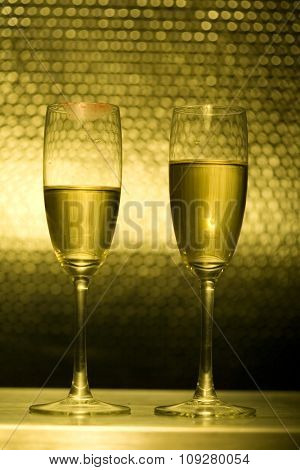 Two Champagne glasses, with woman red  lipstick mouth mark