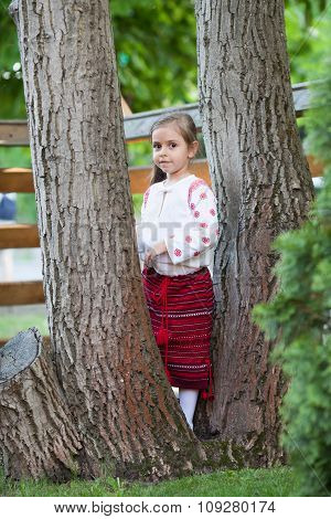 Cute Little Girl Among The Trees