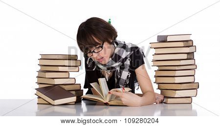 Young student studying between two pile of books