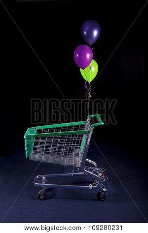 Shopping cart - trolley in dark. Supermarket concept