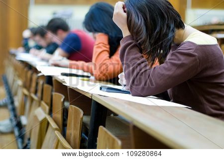 Student in class having an exam in school